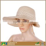 Women's cream sun protection wide brimmed summer straw hat with wind lanyard