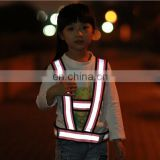 Fluo yellow kids belt reflective safety vest cross the road