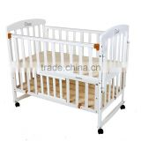 White multifunctional baby bed with storage plank