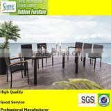 Outdoor furniture rattan dining table with teak wood table top and chair with teak wood armrest for garden furniture