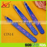 Colorful paint spraying stainless steel finger nail file in beauty salon