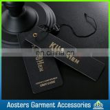 OEM ODM black card paper swing tag with embossed gold foil logo hang tag