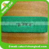 Green cotton headband with embroidered logo