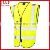 reflective safety vest with pockets and zipper in neon yellow