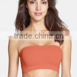 Jinhua xinmei wholesale sports bra push up black silicone bra with strap