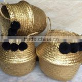 High quality best selling eco-friendly Metallic Gold seagrass baskets with black pompoms from Vietnam