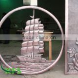 Bronze boat relief in circle sculpture