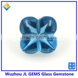 Synthetic glass gem stone with four leaf clover stone