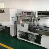 Shanghai hot sale A4 paper book printings magazine shrink packaging machine with L type sealing