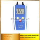 Digital wood moisture meter with 2 pin steel probe for testing wood and building moisture