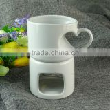 Wholesale white ceramic candle holder, cheap glazed ceramic mug with holder in stock