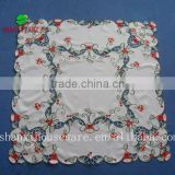 Christmas table cloth with the embroidery of bells and berry