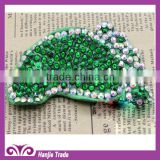 popular dazziling foot shape shoes accessory with green point drill