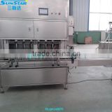 Automatic linear type palm oil packaging machine for olive cooking sunflower oil in bottle barrel or jar can