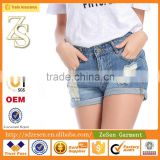 Hot sale Women Apparel Europe Importer Customized Light Blue Ripped Folding Hem Shorts Jeans