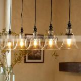 11.28-2 RUSTIC GLASS 5-LIGHT PENDANT provide generous illumination over a bar or long dining table