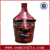 Red top grade funny face resin wine glass bottle