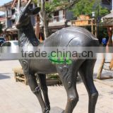 Bronze street side put baby deer sculpture
