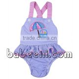 Beach umbrella with sand pail applique girl swimsuit