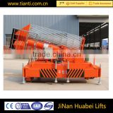 Four wheels pull-behind tilting hydraulic elevator / vertical platform lift /hydraulic cylinder elevating platform