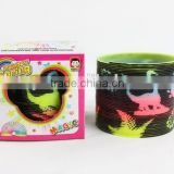 plastic magic rainbow spring toys with printed dinosaur/hot sale rainbow circle