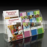 10-pocket, 2-tier clear acrylic brochure holder with removable pocket peg dividers