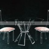 A Set Of Pink Acrylic Banquet Dining Table and Chairs Set