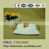 Factory supply stock cheap square white ceramic plate with Metal handle