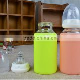 Hot sale durable silicone sleeve milk glass bottle,customized logo/brand/color milk glass bottle