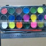 Watercolor paints set with plastic palette and a brush