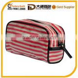 Small clear coated cosmetic bag featuring a coated stripe pattern zippered placket along the top