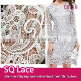 Wholesale polyester embroidery fabric lace dress fabric design chemical lace for garment accessory