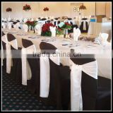 wedding banquet use black chair covers and white romantic chair sashes