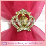 gold brooch of crown with crystal of wedding inviations card decoration