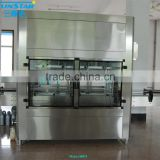 Automatic linear type brake fluid filling machine for olive cooking sunflower oil in bottle barrel or jar can