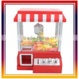 the Claw Candy Toy Candy Grabber machine with lights and music