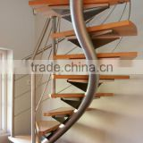 Helical Stairs with Wood Treads and metal railing curved wood staircase
