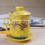 yellow marigold porcelain cup and saucer with insert strainer