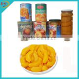 Canned yellow peach dices in syrup