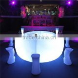 modern garden and outdoor bar counter with illuminated LED stool