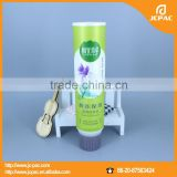 plastic cosmetic tube used for facial cleanser with sponge applicator