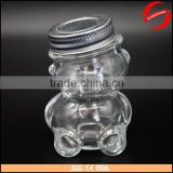 Glass bear shaped honey jar with cap for sale