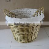 wicker laundry basket with white fabric