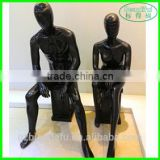 Black full body sitting male sports mannequin for window display