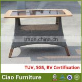 Teak wood with insert black glass top, rattan base outdoor table