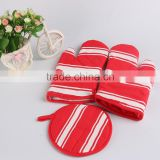 red cotton long oven glove and round pad with white print