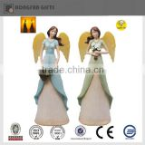 home ornament led painted angel resin figurine with flower on hand