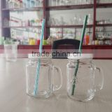 clear drinking glass juice cup with handle and metal lid and straw, glass mason jar, glass bottle                                                                         Quality Choice
