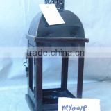 Antique brown metal lantern with clear glass wall