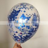 transparent latex balloon within foil confetti